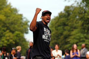 "Marques Armstrong chants in support of Philando Castile, who was fatally shot by Minneapolis area police during a traffic stop on Wednesday, at a ""Black Lives Matter"" demonstration, in front of the Governor's Mansion in St. Paul, Minnesota, U.S., July 7, 2016. Photo By Eric Miller/Reuters"