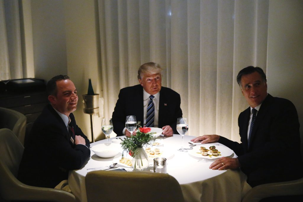 U.S. President-elect Donald Trump sits at a table for dinner with former Massachusetts Governor Mitt Romney (R) and his choice for White House Chief of Staff Reince Priebus (L) at Jean-Georges at the  Trump International Hotel & Tower in New York, U.S., November 29, 2016.  Photo By Lucas Jackson/Reuters