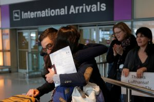 Behnam Partopour, a Worcester Polytechnic Institute (WPI) student from Iran, is greeted by his sister Bahar (L) at Logan Airport after he cleared U.S. customs and immigration on an F1 student visa in Boston, Massachusetts, in February. Photo by Brian Snyder/Reuters