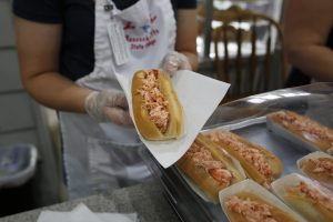 Lobster rolls are for sale in the Massachusetts Grange building on the Avenue of the States during the 100th anniversary of The Eastern States Exposition in West Springfield, Massachusetts, U.S. September 21, 2016. Picture taken on September 21, 2016. REUTERS/Lisa Quinones - RTSOZWS
