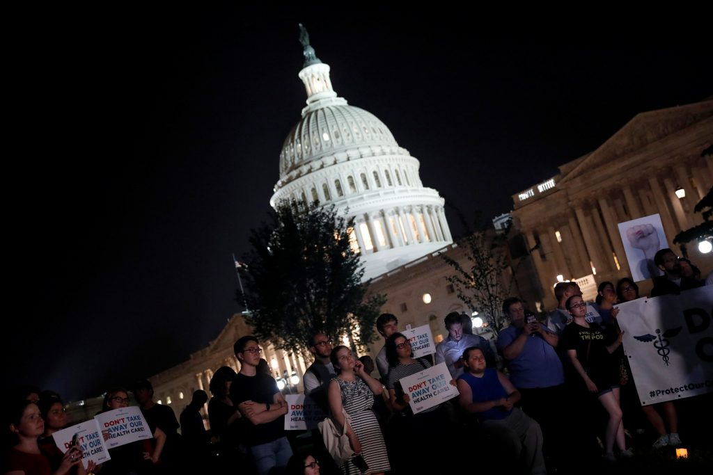 Protesters gather outside the Capitol Building prior to an all night round of health care votes on Capitol Hill in Washington, U.S., July 27, 2017. Photo by Aaron P. Bernstein/ Reuters