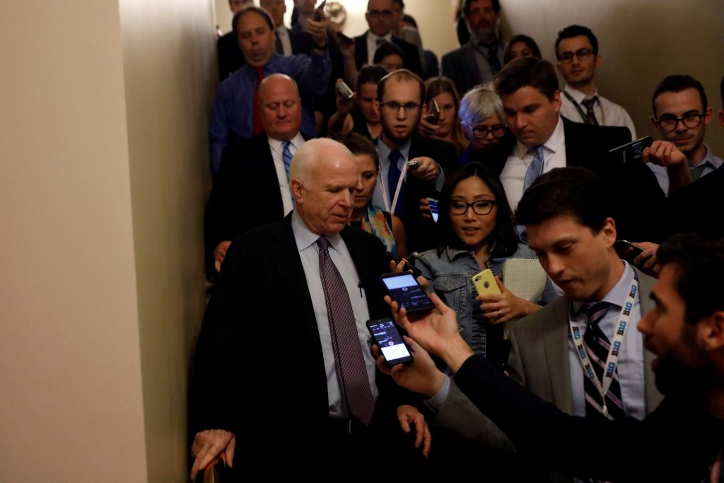 """Senator John McCain (R-AZ) speaks with reporters after voting against the """"skinny repeal"""" health care bill on Capitol Hill in Washington, U.S., July 28, 2017. REUTERS/Aaron P. Bernstein TPX IMAGES OF THE DAY - RTX3D8LS"""