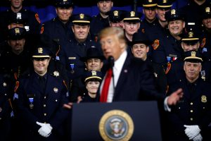 Police officers laugh at a line by President Donald Trump as he delivers remarks about his proposed U.S. government effort against the street gang Mara Salvatrucha, or MS-13, to a gathering of federal, state and local law enforcement officials at the Long Island University campus in Brentwood, New York. Photo by Jonathan Ernst/Reuters