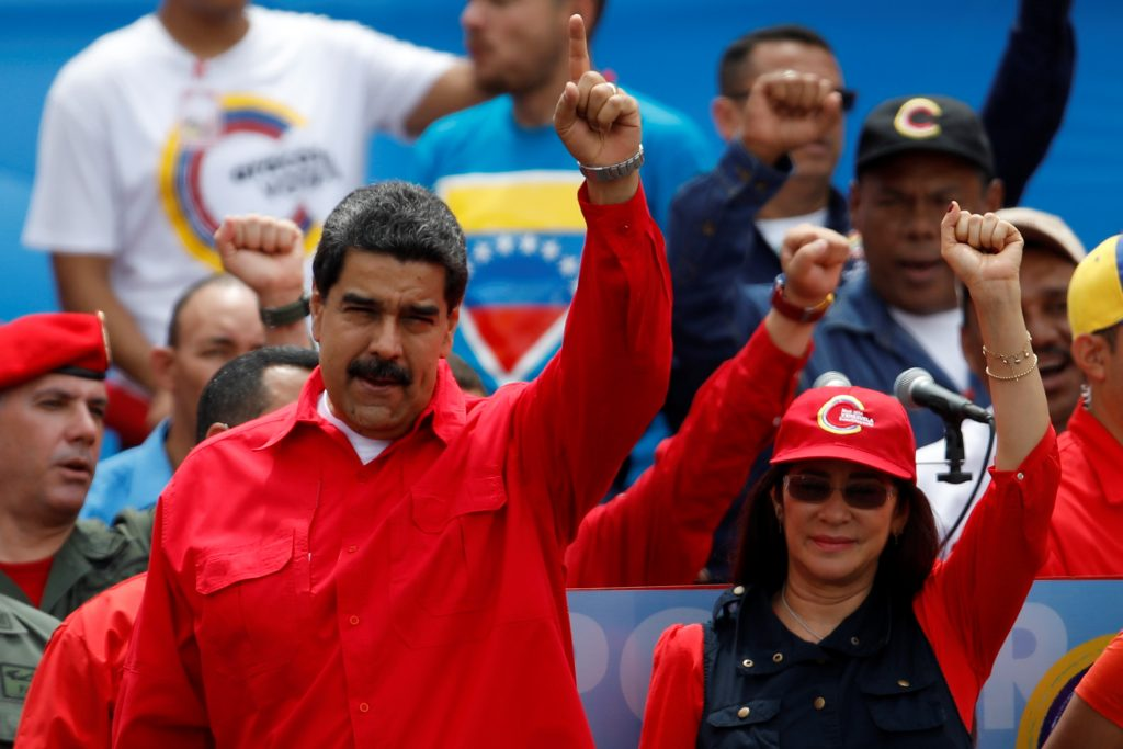 Venezuela's President Nicolas Maduro (L) gestures next to his wife Cilia Flores during the closing campaign ceremony for the upcoming Constituent Assembly election in Caracas, Venezuela, July 27, 2017. Picture taken July 27, 2017. REUTERS/Carlos Garcia Rawlins - RTX3DC2A