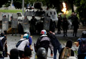 Demonstrators clash with riot security forces while rallying against Venezuela's President Nicolas Maduro's government in Caracas