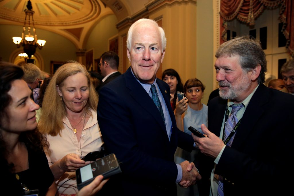 Senator John Cornyn (R-TX) talks to reporters as he arrives for a health care legislation vote on Capitol Hill in Washington, U.S., July 27, 2017. REUTERS/Yuri Gripas - RTX3D770