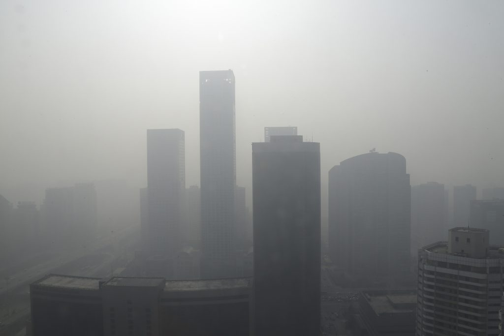 Buildings are seen in heavy haze in Beijing's central business district, January 14, 2013. Photo by Jason Lee/REUTERS