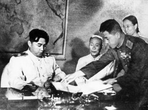 Marshal Kim Il Sung signing the Korean Armistice Agreement and the Temporary Agreement Supplementary to the Armistice Agreement at 10pm on July 27, 1953. Also pictured are (l to r); Kim Du Bong, President of the Standing Committee of the Korean Supreme People's Assembly; General Nam Il; and Bak Cheng Ai, Secretary of the Central Committee of the Korean Nodong Dang. (Photo by: Sovfoto/UIG via Getty Images)