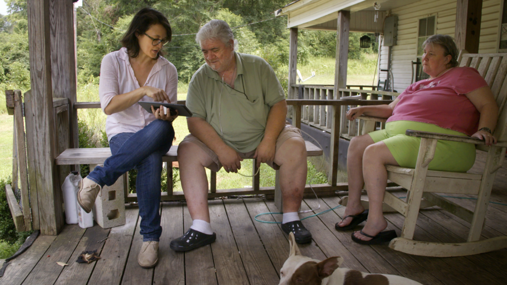 """Jennifer Crandall with Billy and Lucy Wayne, who she met off Route 43, and who read a verse of """"Song of Myself."""""""