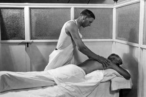 A patient receiving a Swedish massage at the Kellogg's Battle Creek Sanitarium, Battle Creek, Michigan, 1930. Photo by Underwood Archives/Getty Images