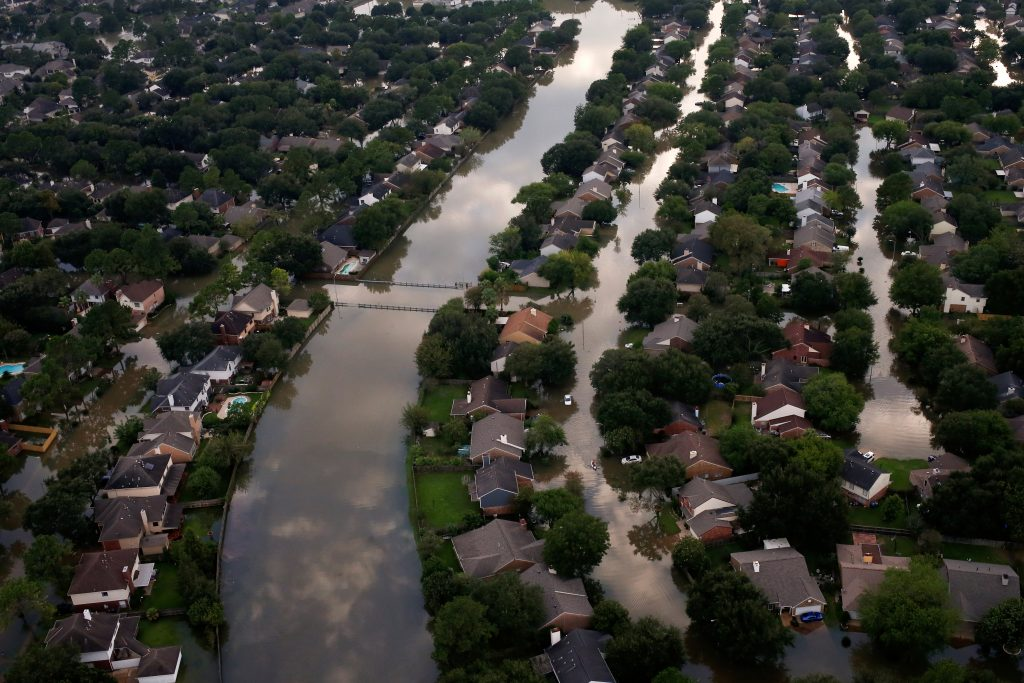 Houses are seen partially submerged in flood waters caused by Tropical Storm Harvey in Northwest Houston, Texas, U.S. Augu...