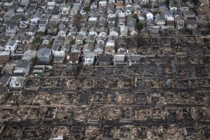 Burnt houses are seen next to those which survived in Breezy Point of Queens, after it was devastated by Hurricane Sandy