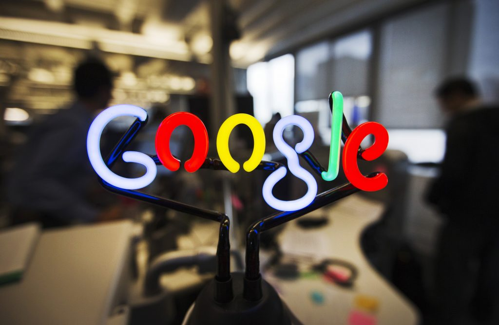 A neon Google logo is seen at the new Google office in Toronto, November 13, 2012. Photo by Mark Blinch/Reuters