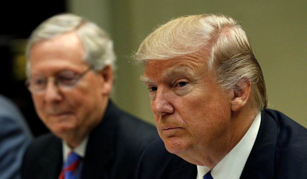 Senate Majority Leader Mitch McConnell (L) sits beside President Donald Trump during a leadership lunch at the White House in Washington, D.C. Photo by Kevin Lamarque/Reuters