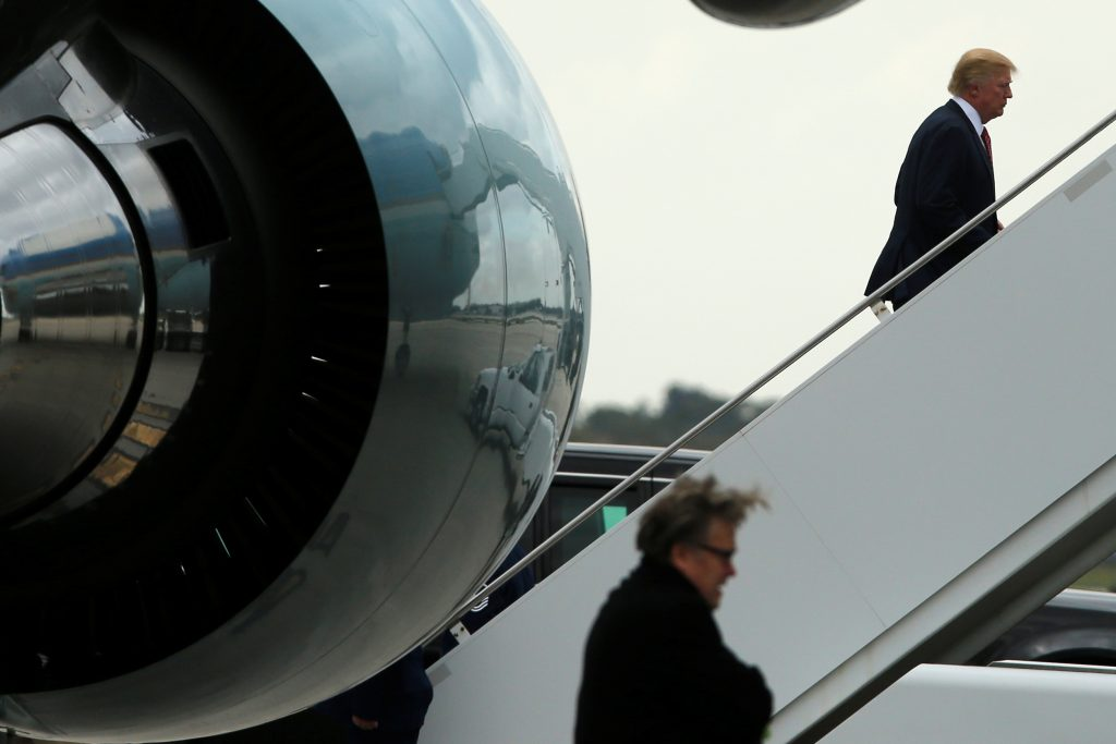 U.S. President Donald Trump (R), trailed by senior adviser Steve Bannon (bottom), boards Air Force One to return to Washington after spending the weekend at the Mar-a-Lago Club, from Palm Beach International Airport in West Palm Beach, Florida, U.S. March 5, 2017. REUTERS/Jonathan Ernst