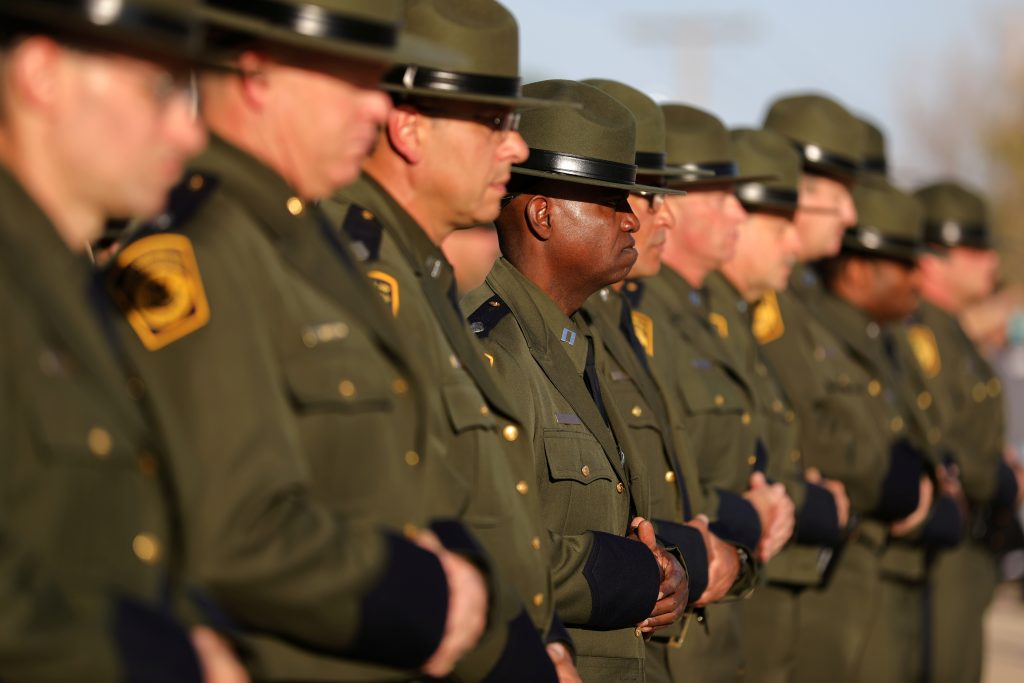 Border patrol agents listen to a graduation ceremony at the United States Border Patrol Academy in Artesia, New Mexico, U.S., June 9, 2017. REUTERS/Lucy Nicholson