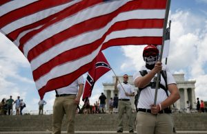 """Demonstrator holds a United States flag in front of another waving a Confederate flag as self proclaimed """"White Nationalists"""" and """"Alt-Right"""" activists hold """"Freedom of Speech"""" rally at Lincoln Memorial in Washington"""