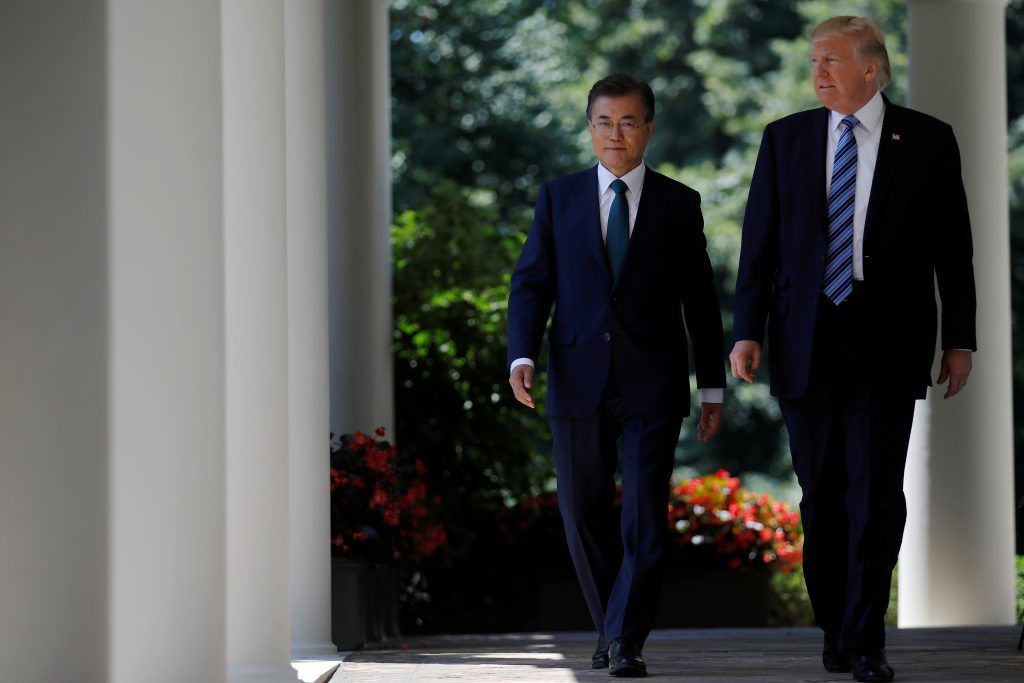 U.S. President Donald Trump (R) arrives for a joint news conference with South Korean President Moon Jae-in (L) in the Rose Garden of the White House in Washington, U.S.