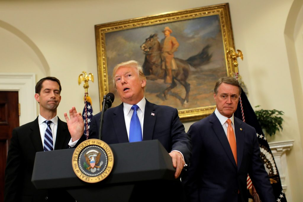 U.S. President Donald Trump speaks during an announcement on immigration reform accompanied by Senator Tom Cotton (R-AR) (L) and Senator David Perdue (R-GA) (R), in the Roosevelt Room of the White House in Washington, U.S., August 2, 2017. REUTERS/Carlos Barria - RTS1A4QX