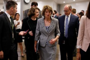 Senator Lisa Murkowski (R-AK) speaks with reporters ahead of a vote on Capitol Hill in Washington, U.S., August 2, 2017. REUTERS/Aaron P. Bernstein - RTS1A4ZA