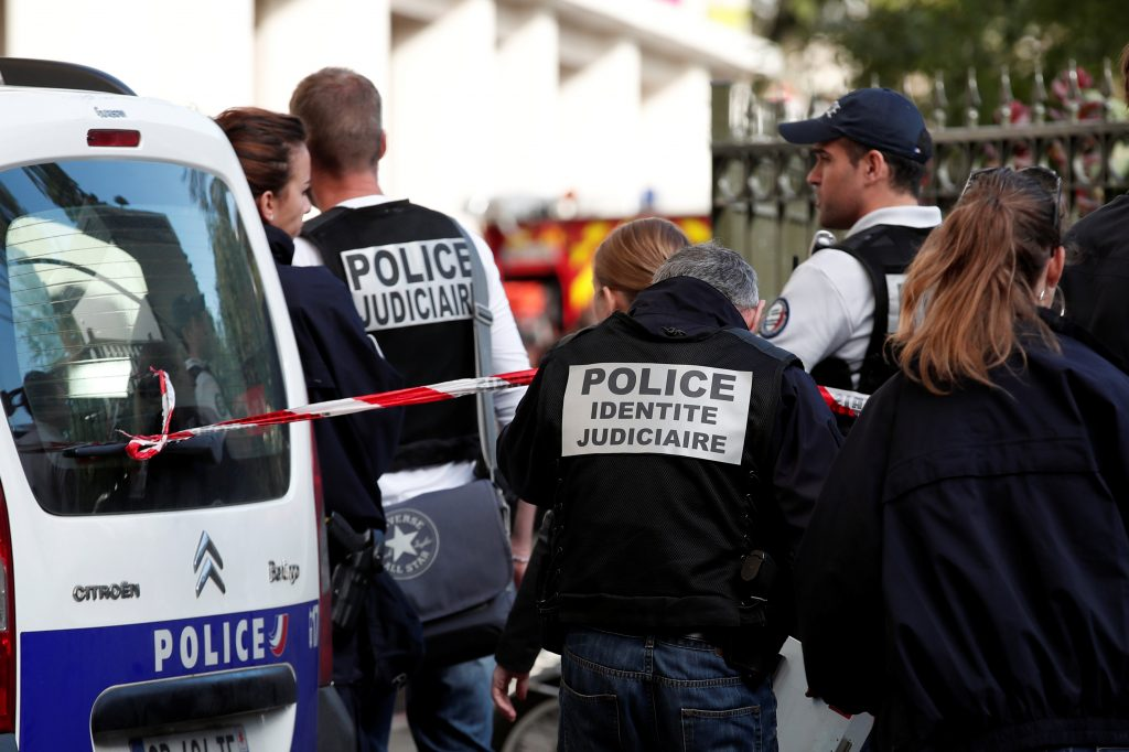 Police work near the scene where French soliders were hit and injured by a vehicle in the western Paris suburb of Levallois-Perret