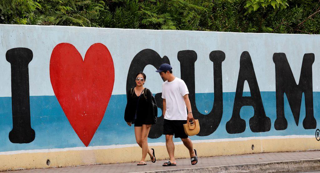 Tourists stroll along a road on the island of Guam, a U.S. Pacific Territory, August 10, 2017.  REUTERS/Erik De Castro