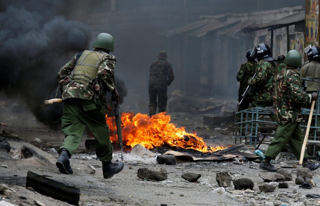 Anti riot policemen clash with protesters supporting opposition leader Raila Odinga in Mathare, in Nairobi, Kenya August 12, 2017. REUTERS/Thomas Mukoya/ Reuters