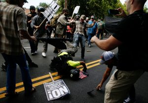 A man hits the pavement during a clash between members of white nationalist protesters against a group of counter-protesters in Charlottesville
