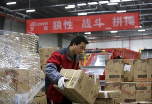 FILE PHOTO - An employee works at a JD.com logistic centre in Langfang, Hebei province, November 10, 2015. REUTERS/Jason Lee/File Photo GLOBAL BUSINESS WEEK AHEAD SEARCH GLOBAL BUSINESS 14 AUG FOR ALL IMAGES - RTS1BOOR