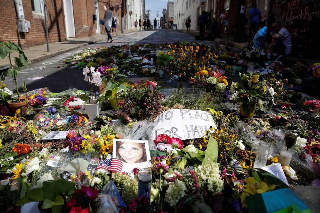 Flowers are pictured on the street where Heather Heyer was killed when a suspected white nationalist crashed his car into ...