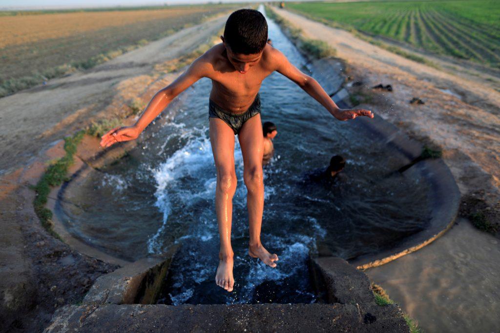 As the battle to retake Raqqa rages, children in Syria find their own fun. Photo by Zohra Bensemra/Reuters