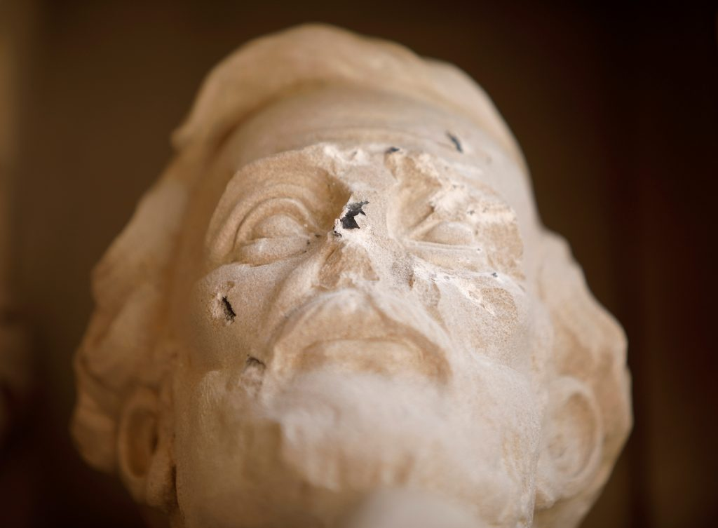 Damage done to the face of a statue of Confederate commander General Robert E. Lee is seen, at Duke University's Duke Chapel in Durham