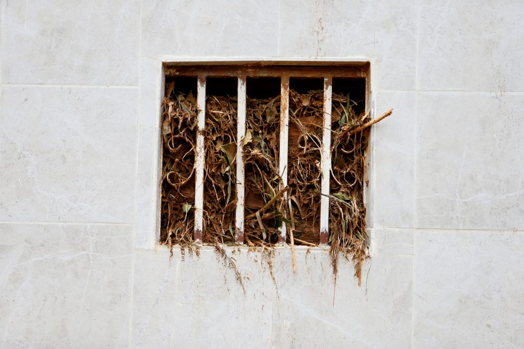 Debris is seen inside the window of a house left along the valley after the flash flood at Pentagon, Regent town, Sierra Leone. Photo by Afolabi Sotunde/Reuters