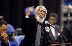 FILE PHOTO - Activist Dick Gregory delivers a speech during a public viewing and funeral for legendary singer James Brown in Augusta