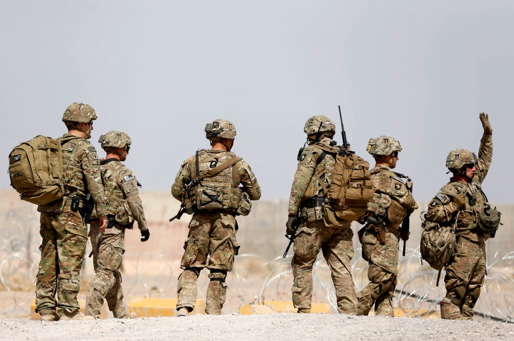 FILE PHOTO: U.S. troops walk outside their base in Uruzgan province, Afghanistan July 7, 2017. REUTERS/Omar Sobhani/File Photo - RTS1CL1M