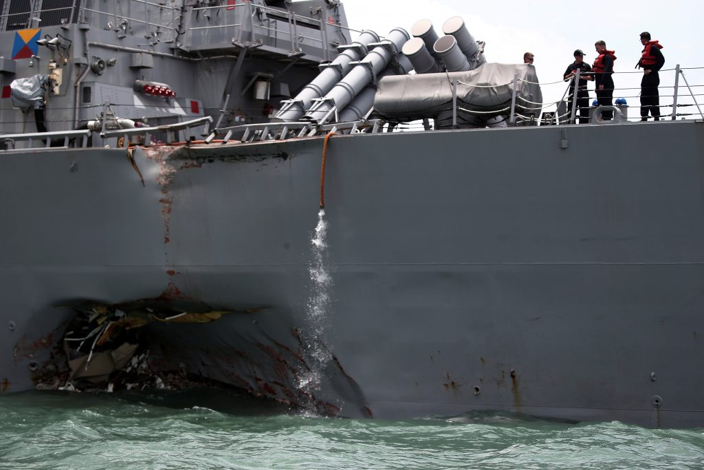 The U.S. Navy guided-missile destroyer USS John S. McCain is seen after a collision, in Singapore waters August 21, 2017. REUTERS/Ahmad Masood - RTS1CLJD