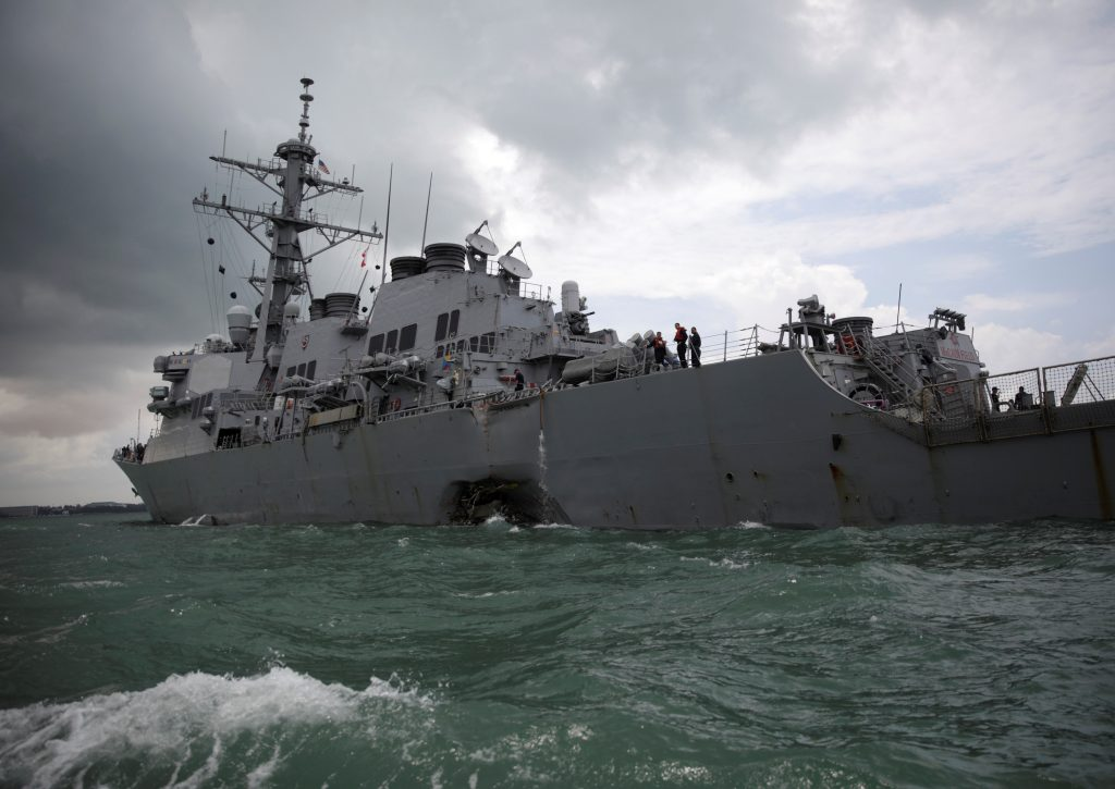 The U.S. Navy guided-missile destroyer USS John S. McCain is seen after a collision, in Singapore waters. Photo by Ahmad Masood/Reuters