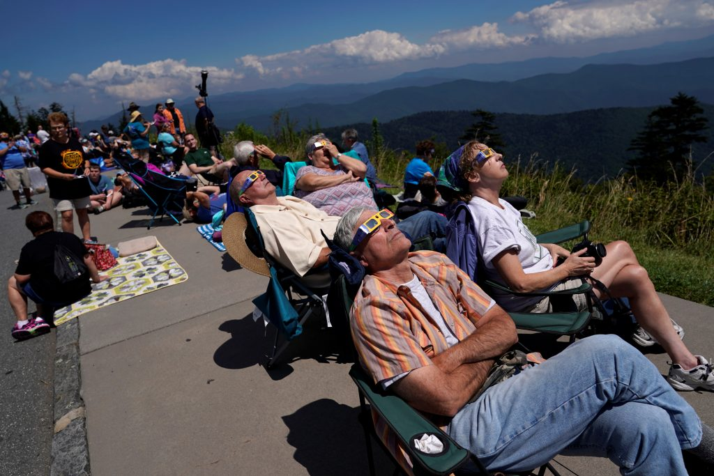 People watch as the solar eclipse approaches totality from Clingmans Dome, the highest point in the Great Smoky Mountains National Park, Tennessee. Photo by Jonathan Ernst/Reuters