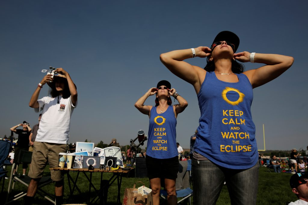 People watch the solar eclipse in Madras, Oregon, on Aug. 21. Photo by Jason Redmond/Reuters