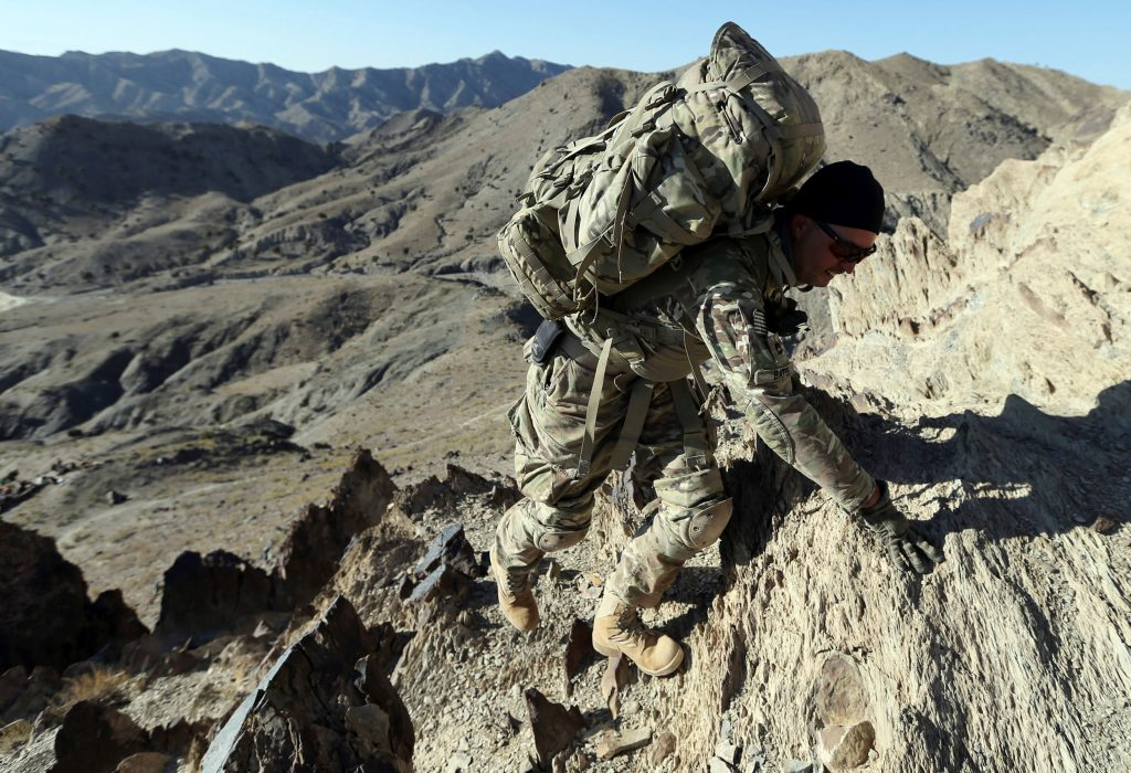 A U.S. soldier climbs a hill in Paktika province in southeastern Afghanistan. File photo by Goran Tomasevic/Reuters
