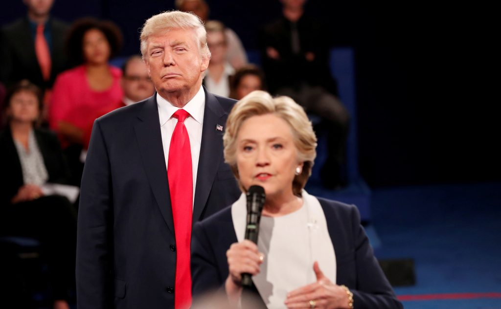Donald Trump listens as then-Democratic nominee Hillary Clinton answers a question from the audience during their presidential town hall debate at Washington University in St. Louis, Missouri. Photo by Rick Wilking/Reuters