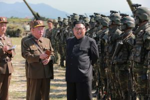 File photo of North Korean leader Kim Jong Un with the Korean People's Army is from KCNA via Reuters