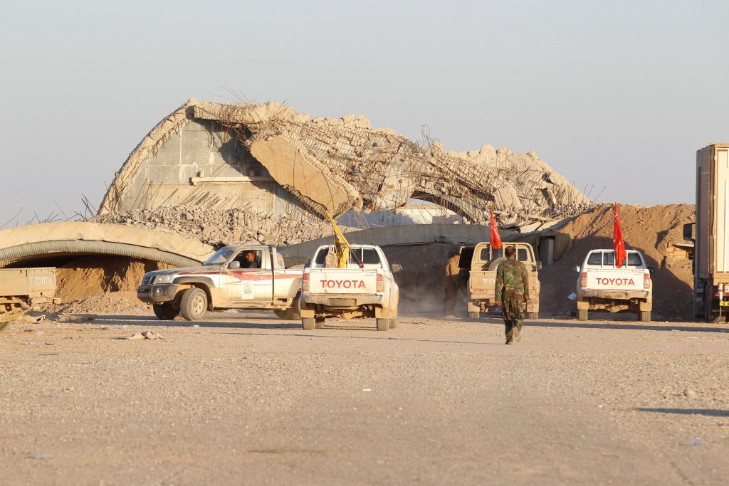 Members of the Shi'ite Badr Organisation fighters gather during a battle with Islamic State militants at the airport of Tal Afar