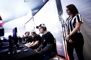 "A referee watches over competitors play ""Call of Duty: Infinite Warfare"" on the Playstation 4, during the Cineplex WorldGaming Canadian Championship Series, an esports video game tournament for $65,000 (CAD) total prize money, in Toronto, Ontario, Canada, March 26, 2017. Picture taken March 26, 2017. REUTERS/Mark Blinch - RTX32WI9"