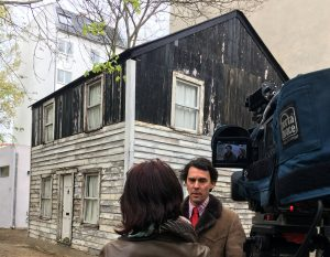 Artist Ryan Mendoza gives an interview in front of Rosa Parks' house on his property in Berlin on April 11. Photo by Oliver Barth/Reuters