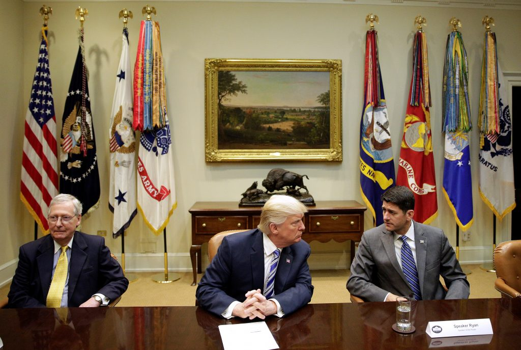 U.S. President Donald Trump meets with Senate Majority Leader Mitch McConnell (R-KY) and Speaker of the House Paul Ryan (R-WI) during a meeting with Republican Congressional leaders at the White House in Washington, U.S., June 6, 2017. REUTERS/Joshua Roberts TPX IMAGES OF THE DAY - RTX39BZA