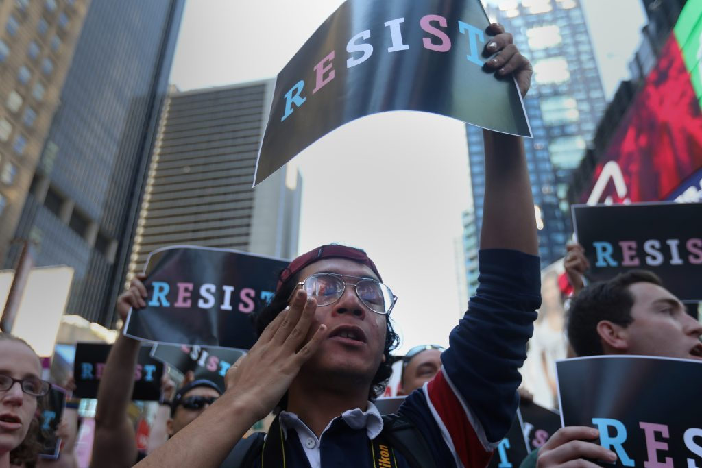 A participant cries during a protest against U.S. President Donald Trump's announcement that he plans to reinstate a ban on transgender individuals from serving in any capacity in the U.S. military, in Times Square, in New York City