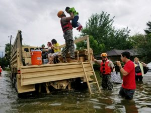 Texas National Guardsmen aid residents flooded by Hurricane Harvey in Houston, Texas, on Aug. 27. Photo by Lt. Zachary West, 100th MPAD/Texas Military Department/Handout via Reuters
