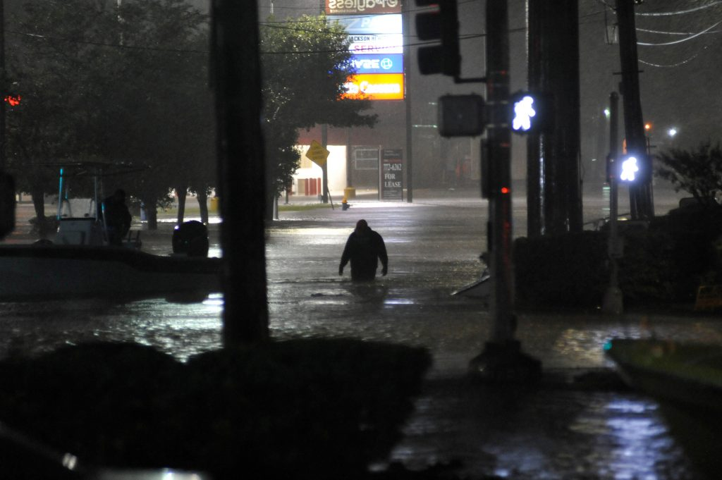 A man wades through floodwater after Hurricane Harvey inundated the Texas Gulf coast with rain causing widespread flooding...
