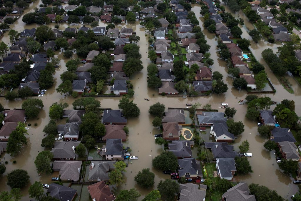 Houses are seen submerged in flood waters caused by Tropical Storm Harvey in Northwest Houston, Texas, U.S. August 30, 2017. REUTERS/Adrees Latif - RTX3E2BJ